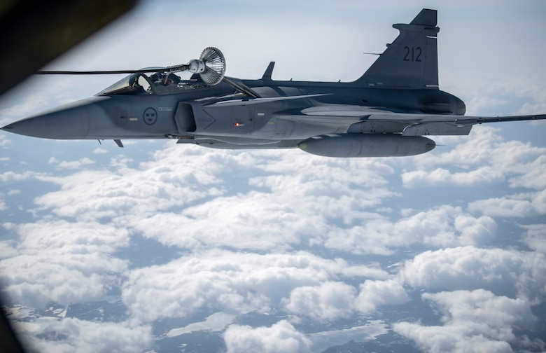 A Swedish Armed Forces Gripen receives fuel from a KC-135 Stratotanker from the 100th Air Refueling Wing, RAF Mildenhall, England, during a Bomber Task Force Europe mission over Sweden, May 20, 2020. The mission marked the first time B-1s have flown over Sweden to integrate with Swedish Gripens while conducting close-air support training with Swedish Joint Terminal Attack Controller ground teams at Vidsel Range. (U.S. Air Force photo by Tech. Sgt. Emerson Nuñez)