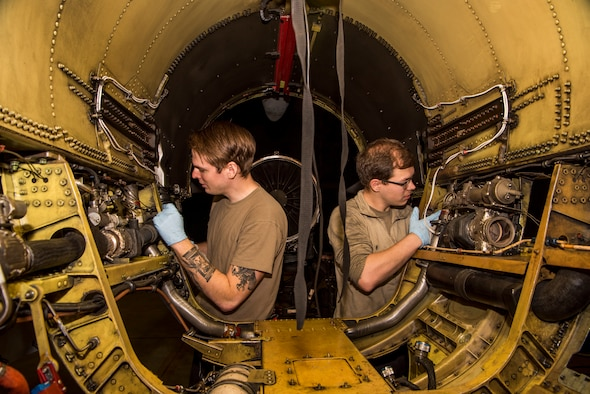 U.S. Air Force Staff Sgt. Derek Wallace, left, 52nd Aircraft Maintenance Squadron dedicated crew chief, and Senior Airman Dylan Nugent, right, 52nd AMXS assistant dedicated crew chief, wipe down and inspect the inside of an F-16 Fighting Falcon at Spangdahlem Air Base, Germany, May 8, 2020. A cleaning and inspection was performed after the aircraft's engine was removed for scheduled maintenance. (U.S. Air Force photo by Airman 1st Class Alex Miller)