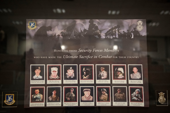 A memorial bears the names and images of fallen security forces Airmen during a Final Guard Mount ceremony May 15, 2020, at Incirlik Air Base, Turkey. The 39th Security Forces Squadron conducted the ceremony to conclude National Police Week. (U.S. Air Force photo by Staff Sgt. Joshua Magbanua)