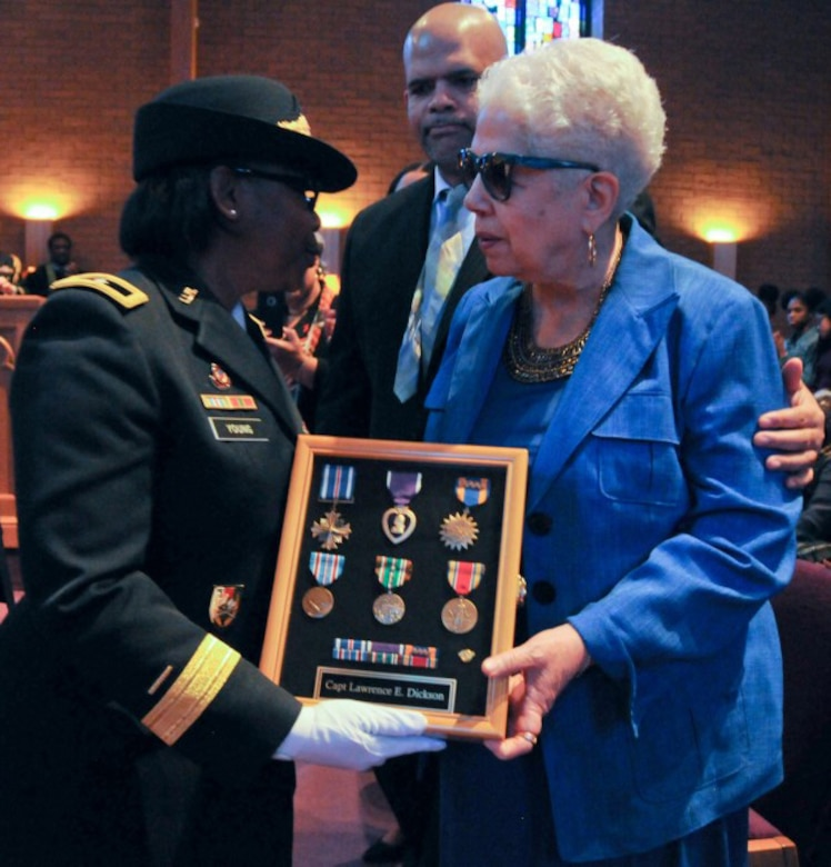 Marla L. Andrews (right), daughter of U.S. Army Air Forces Capt. Lawrence E. Dickson, receives her father's medals from Brig. Gen. Twanda E. Young, deputy commanding general of the U.S. Army's Human Resources Command, during a Feb. 24, 2019 ceremony held in Summit, New Jersey.