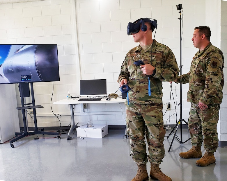 Chief Master Sgt. Thomas Blount, 461st Air Control Wing command chief, virtually looks at the E-8C Joint Surveillance Target Attack Radar System aircraft as with Master Sgt. Justin Ciszek, Robins Spark Hub noncommissioned officer-in-charge, at Robins Air Force Base, Georgia April 13, 2020. Virtual reality was brought to Team JSTARS to assist training maintainers remotely in a controlled environment.