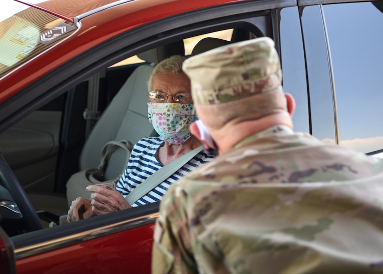 U.S. Air Force Col. Andres Nazario, 17th Training Wing commander, talks with a retiree on Goodfellow Air Force Base, Texas, May 20, 2020. Nazario reminded retirees that face coverings must be worn at all times while on Goodfellow. (U.S. Air Force photo by Airman 1st Class Ethan Sherwood)