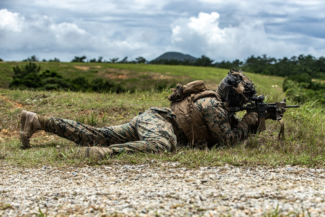 A U.S. Marine holds a defensive position during live- fire anti-armor transition drills on Camp Schwab, Okinawa, Japan, May 17, 2020.