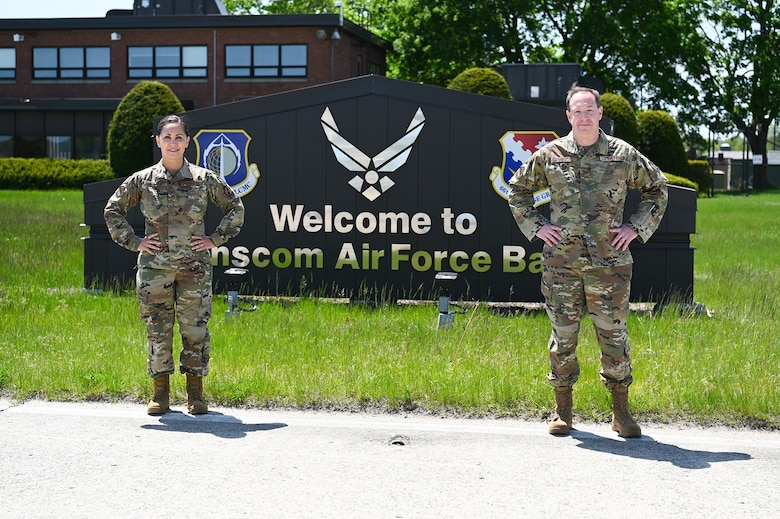 Col. Mark Wilson and Master Sgt. Teresa Baker-Opland, Individual Mobilization Augmentees to the 66th Air Base Group commander and Inspector General Office superintendent, pose for a photo on the flight line at Hanscom Air Force Base, Mass., May 19. Both reserve citizen Airmen were activated to serve on Hanscom's COVID-19 task force in March of this year. (U.S. Air Force photo by Todd Maki)