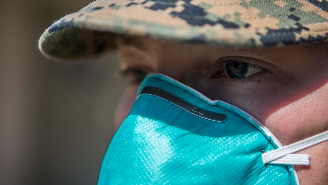 A U.S. Marine practices precautionary measures by wears proper protective equipment on Marine Corps Air Station Miramar, Cali., March 25, 2020.