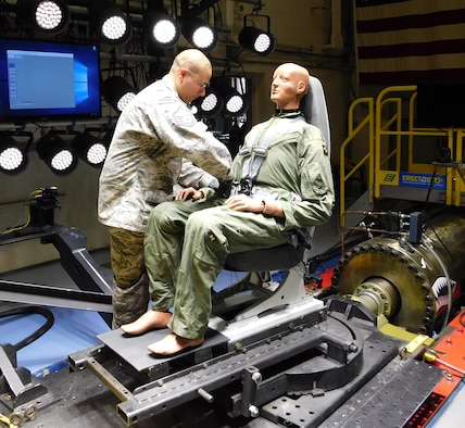 Master Sgt. James Chase of the AFRL 711th Human Performance Wing Biodynamics team prepares an instrumented 250-pound test device, simulating a human occupant, for seat testing on the Horizontal Impulse Accelerator, located at Wright-Patterson Air Force Base. The test is one of a series recently conducted to support the acceptance and implementation of the Portable Biocontainment Care Module, which will aid in the safe transport of personnel affected by infectious diseases, including COVID-19. (Photo courtesy of Infoscitex Corporation/Christopher Albery)
