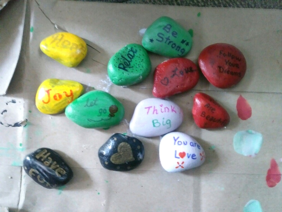 Sports and Fitness Facility Manager Martha Kerns prepares her rocks to share during the KIndness Rock Scavenger Hunt.Participants are encouraged to decorate rocks they can leave along popular trails to inspire those who find them.