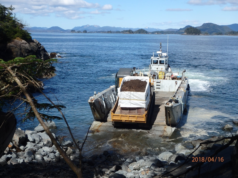 Beyond the immense amount of contamination at the landfill, one of the greatest challenges of the project was logistics while access is limited to marine vessels only. Shown here, a Marooka loaded with contaminated soil drives onto a landing craft at the historical park.