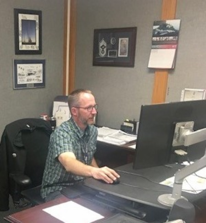 Michael Holmquist, 673LRS materiel management flight chief, performs administrative duties at Joint Base Elmendorf-Richardson, Alaska,  May 15, 2020.