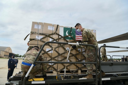 89th Airlift Wing Airmen unload a Pakistan air force C-130 at Joint Base Andrews, Md., May 21, 2020. The donated materials were sent to the Federal Emergency Management Agency in support of the fight against COVID-19. (U.S. Air Force photo by Airman 1st Class Spencer Slocum)