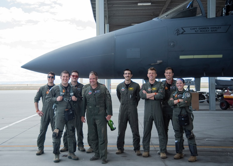 "U.S. Air Force Lt. Col. Aaron C. ""Badger"" Lapp, 366th Fighter Wing director of operations and plans, poses with his fellow pilots, May 15, 2020, on Mountain Home Air Force Base, Idaho. During his time in service, Lapp has flown five different types of aircraft such as the T-38 Talon, T-37 Tweet, F-15E Strike Eagle, F-15SG Strike Eagle and F/A-18 Super Hornet. (U.S. Air Force photo by Airman 1st Class Akeem K. Campbell)"