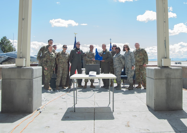 "U.S. Air Force Lt. Col. Aaron C. ""Badger"" Lapp, 366th Fighter Wing director of operations and plans, poses with fellow Airmen after receiving a going away memento from Col. Tony S. Lombardo, 366th Fighter Wing chief of staff, May 15, 2020, on Mountain Home Air Force Base, Idaho. Lapp has served the Air Force for 20 years and one month and has over 3,000 flight hours and 900 Combat hours. (U.S. Air Force photo by Airman 1st Class Akeem K. Campbell)"