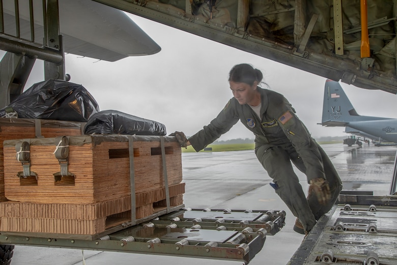 Staff Sgt. Sarah Meadows, 36th Airlift Squadron C-130J loadmaster, loads a low-cost, low-altitude bundle onto a C-130J Super Hercules at Yokota Air Base, Japan, May 21, 2020, during the Samurai Surge training exercise.