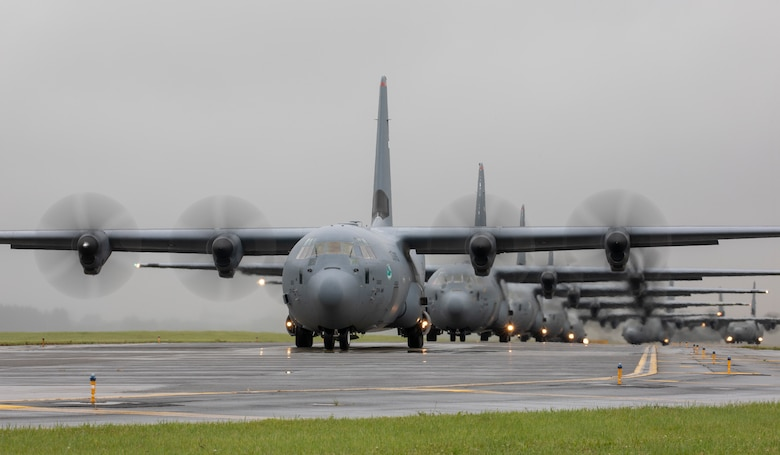 Seven C-130J Super Hercules' assigned to the 36th Airlift Squadron taxi on the runway at Yokota Air Base, Japan, May 21, 2020, during the Samurai Surge training exercise