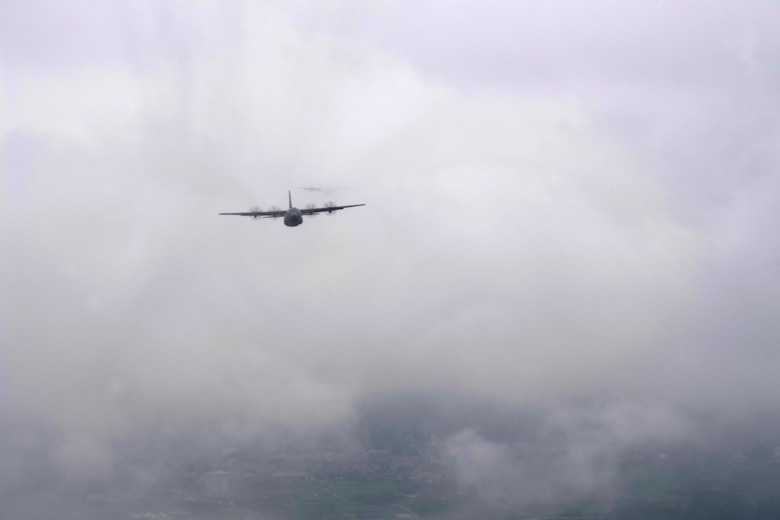 A C-130J Super Hercules, assigned to the 36th Airlift Squadron, flys through the clouds above the Yokota Air Base, Japan, flightline during the formation flight portion of the Samurai Surge training exercise, May 21, 2020.