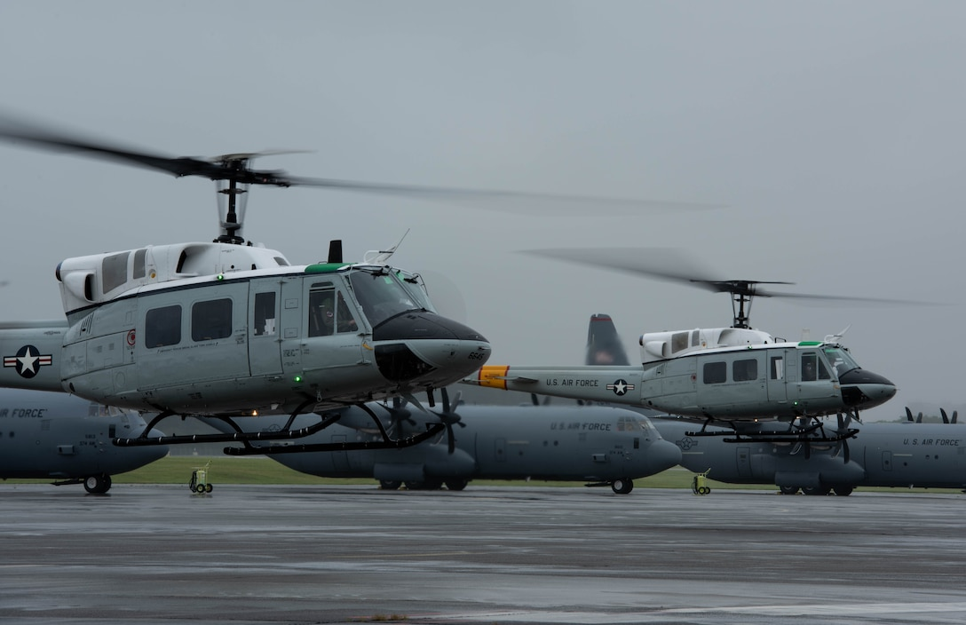 Two UH-1N Iroquois with the 459th Airlift Squadron take off during the 374th Airlift Wing's Samurai Surge training exercise, May 21, 2020, at Yokota Air Base, Japan.