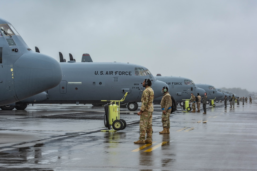 C-130J Super Hercules aircraft with the 36th Airlift Squadron sit on the flight line for pre-flight inspections prior to starting the elephant walk portion of the Samurai Surge training exercise, May 21, 2020, at Yokota Air Base, Japan.