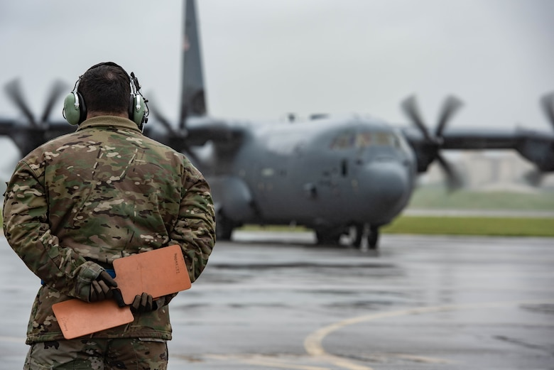 A crew chief assigned to the 374th Aircraft Maintenance Squadron prepares to marshal C-130J Super Hercules during the 374th Airlift Wing's Samurai Surge training exercise, May 21, 2020, at Yokota Air Base, Japan.