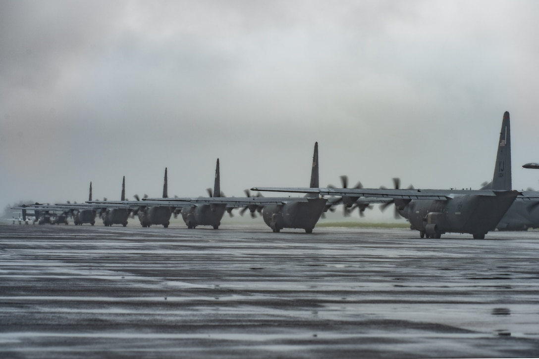 Multiple C-130J Super Hercules aircraft with the 36th Airlift Squadron taxi on the flight line during the elephant walk portion of the Samurai Surge training exercise, May 21, 2020, at Yokota Air Base, Japan.