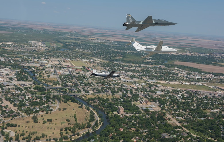 A T-6 Texan II, T-1A Jayhawk and a T-38C Talon, assigned to Laughlin Air Force Base, Texas, perform a flyover in San Angelo, Texas, May 21, 2020. Laughlin performed flyovers in three Texas cities as a part of the America Strong America Salutes Campaign, to show its gratitude for all front-line responders, economy sustainers and community members in the COVID-19 pandemic. (U.S. Air Force photo by Staff Sgt. Benjamin N. Valmoja)