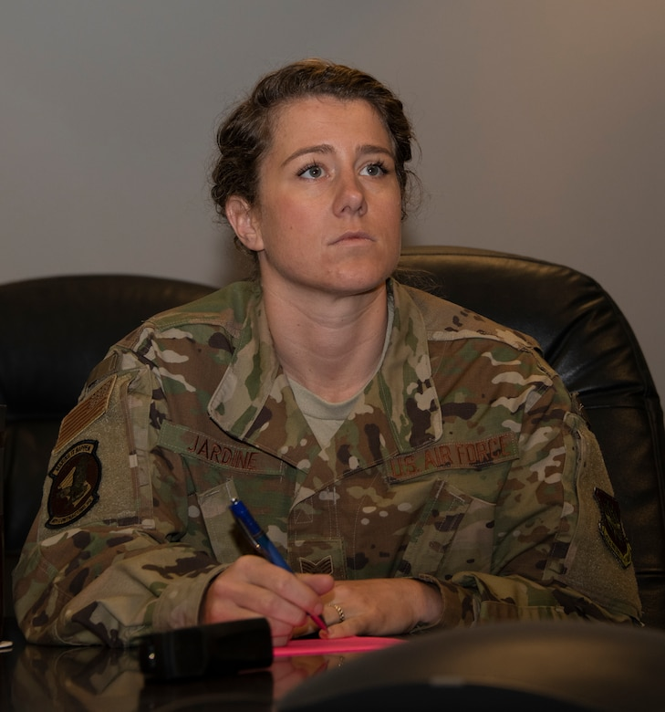 U.S. Air Force Staff Sgt. Amanda Jardine, 60th Contracting Squadron contracting officer, listens to a presentation May 20, 2020, during a commercial solutions opening event at Travis Air Force Base, California. The event, the first of its kind in Travis AFB history, was organized by the Travis Phoenix Spark Innovation Cell and the 60th CONS. (U.S. Air Force photo by Tech. Sgt. James Hodgman)