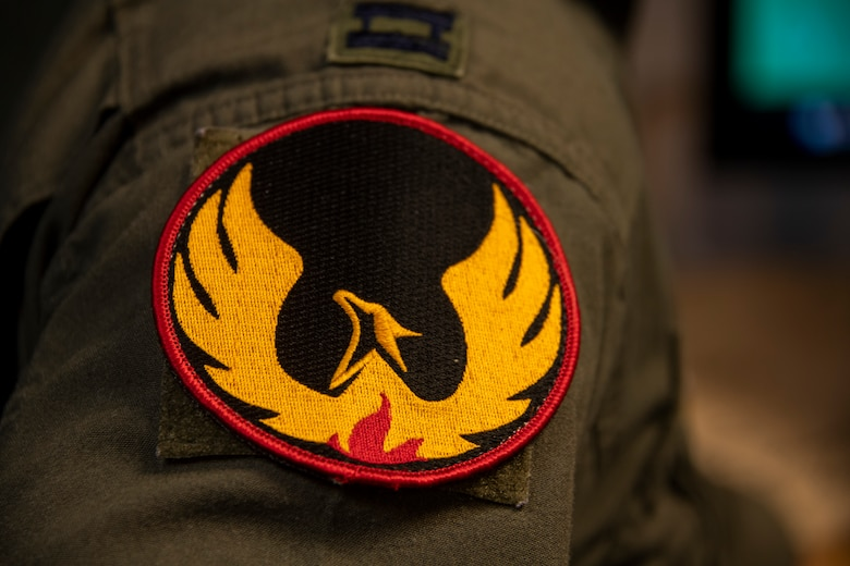 The 60th Air Mobility Wing Phoenix Spark innovation cell patch is attached to the right shoulder of U.S. Air Force Capt. Christopher Williston's flight suit May 20, 2020, at Travis Air Force Base, California. Williston is a 21st Airlift Squadron C-17 Globemaster III pilot and the deputy chief of the innovation cell. He helped organize a commercial solutions offering event with the 60th Contracting Squadron so companies could provide innovate solutions to enhance the Travis AFB mission. (U.S. Air Force photo by Tech. Sgt. James Hodgman)