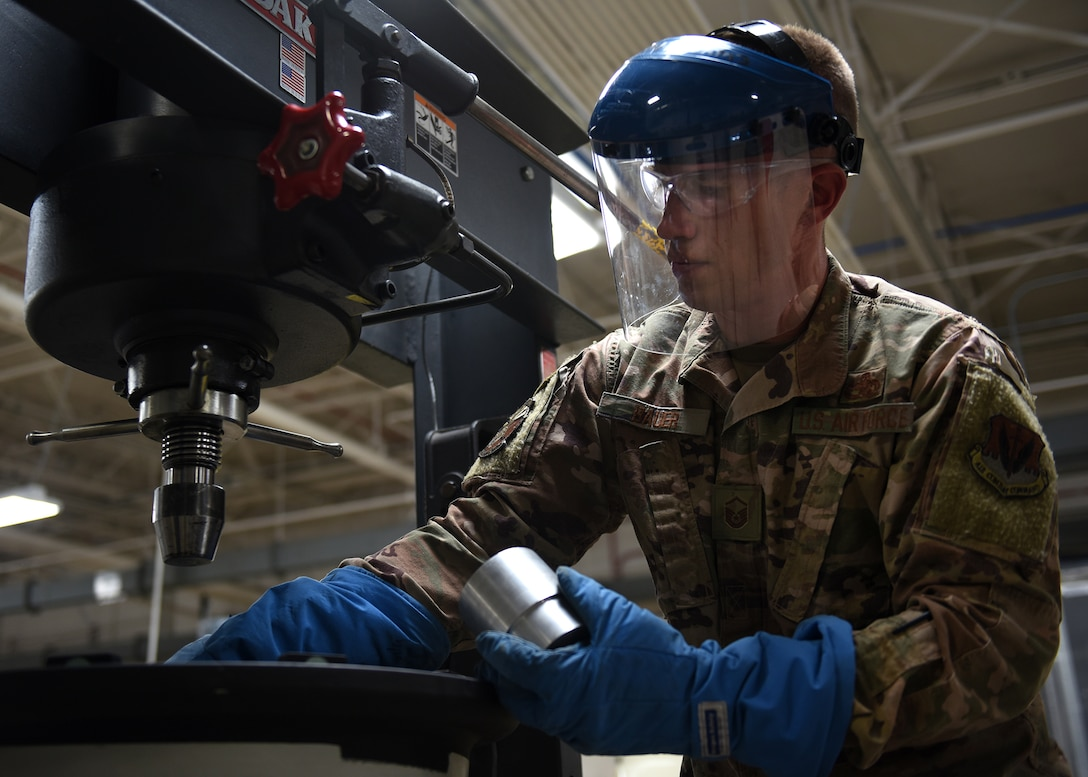 A photo of an Airman working working with tools.