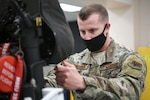 A photo of Staff Sgt. Cameron Westin working on an F-35A ejection seat