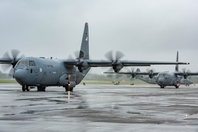 Two C-130J Super Hercules with the 36th Airlift Squadron taxi on the flight line during the elephant walk portion of the Samurai Surge training exercise, May 21, 2020, at Yokota Air Base, Japan.