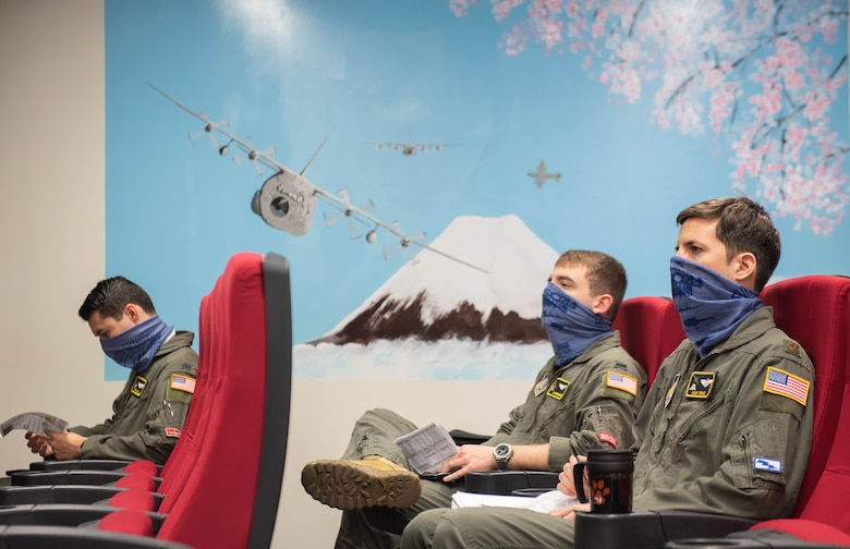 Aircrews conduct a physically distant pre-flight briefing before stepping out to their aircraft as part of the 374th Airlift Wing's Samurai Surge training exercise.