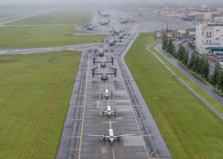 Aircraft from the 36th Airlift Squadron, 459th Airlift Squadron and 21st Special Operations Squadron taxi their way across the Yokota Air Base, Japan, flightline during the