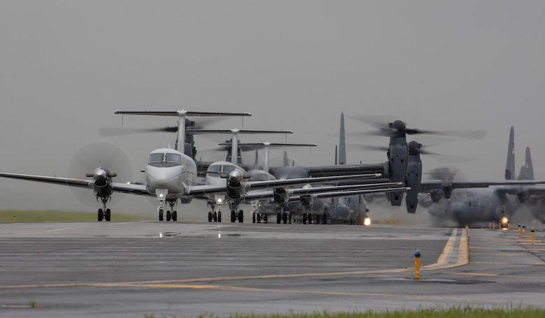 Aircraft from the 36th Airlift Squadron, 459th Airlift Squadron and 21st Special Operations Squadron taxi their way across the Yokota Air Base, Japan flightline during the elephant walk portion of the Samurai Surge training exercise, May 21, 2020.