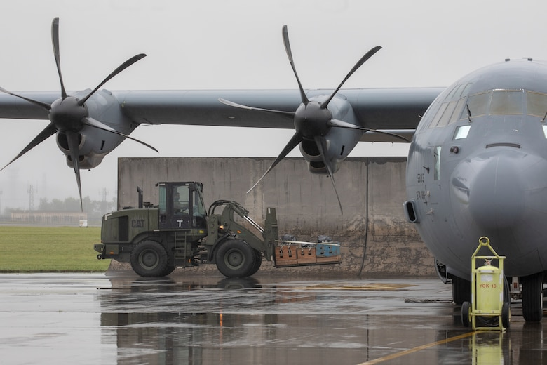 An Airman with the 374th Logistics Readiness Squadron combat mobility flight loads low-cost, low-altitude bundles with a forklift into a C-130J Super Hercules at Yokota Air Base, Japan, May 21, 2020, during the Samurai Surge training exercise.