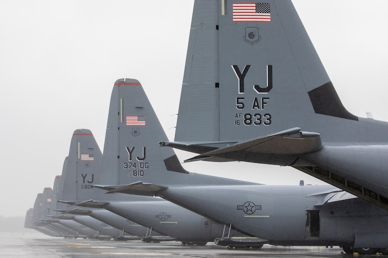 Nine C-130J Super Hercules assigned to the 36th Airlift Squadron wait on the flightline during the Samurai Surge training exercise at Yokota Air Base, Japan, May 21, 2020.
