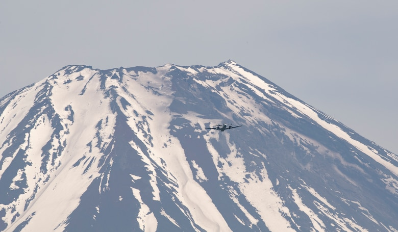 A C-12 Huron assigned to the 459th Airlift Squadron flies over Mount Fuji, May 14, 2020, during a pre-Samurai Surge training exercise.