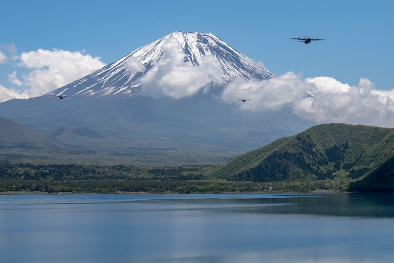 Three C-130J Super Hercules' assigned to the 36th Airlift Squadron fly over Lake Motosu, May 11, 2020, during a pre-Samurai Surge training exercise.