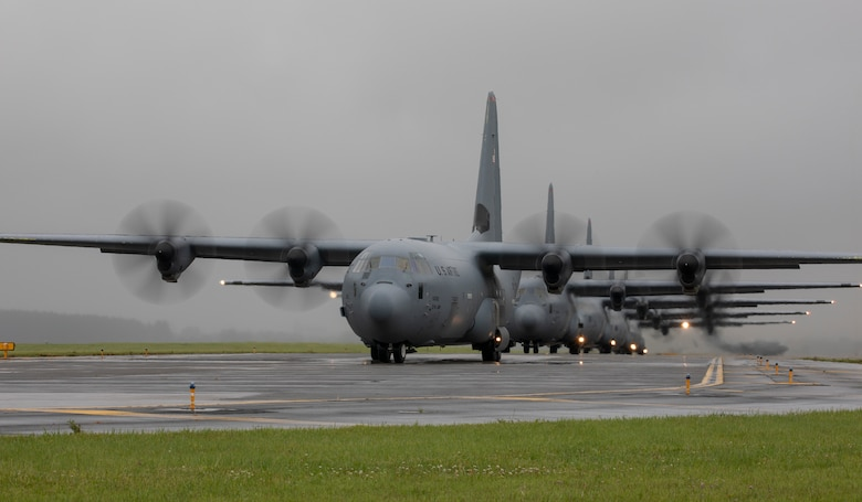 Seven C-130J Super Hercules aircraft from the 374th Airlift Wing fly line up on the flightline as part of the elephant walk portion of the Samurai Surge training exercise at Yokota Air Base, Japan, May 21, 2020.