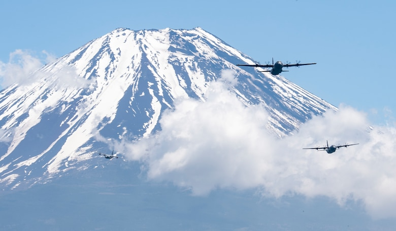 Three C-130J Super Hercules' assigned to the 36th Airlift Squadron fly over Mount Fuji, May 11, 2020, during a pre-Samurai Surge training exercise.