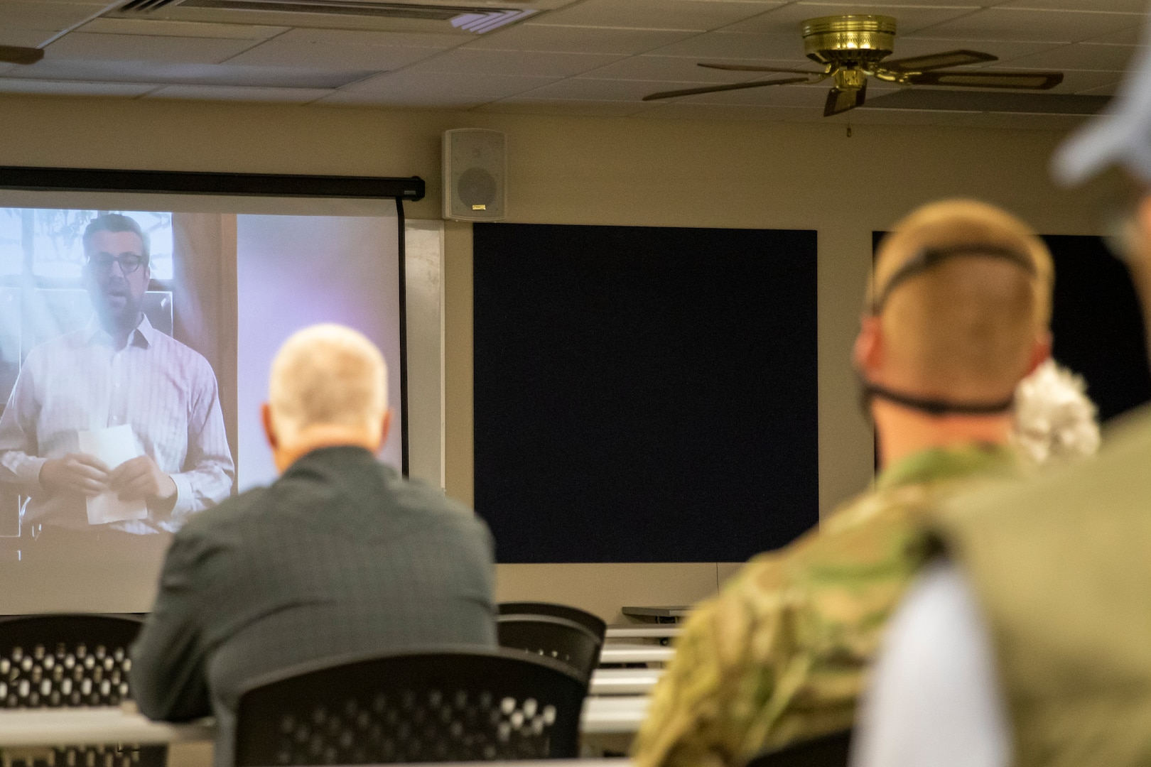 Seven Nebraska Army National Guard Soldiers with the 181st Engineer Detachment (Firefighter Team) and their families watch recorded video messages from government leaders including Norfolk Mayor Josh Moenning (on screen left), May 17, 2020, during a brief send-off ceremony before their yearlong overseas deployment to Romania.
