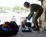 Pfc. Lydia Humphrey, 1073rd Maintenance Company, Michigan Army National Guard, assists Anita Wheeler from Midland, Michigan, as the Guard responds to flooding caused by dam breaches May 20, 2020. Michigan National Guard units from Bay City, Saginaw, Port Huron and other nearby communities helped evacuate people.
