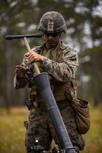 U.S. Marine Corps Lance Cpl. Devlin Trosky, an Orange County, New Jersey native and mortarman with 1st Battalion, 8th Marine Regiment, 2d Marine Division, cleans an M252 81 mm mortar system during a battalion field exercise at Camp Lejeune, North Carolina, May 14, 2020. The field exercise focused on mortar positioning and countering adversary artillery. (U.S. Marine Corps photo by Lance Cpl. Patrick King)