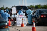 Oklahoma Army and Air National Guard members help conduct COVID-19 testing at the Texas County Activity Center in Guymon, Oklahoma, May 16, 2020. Guymon had more cases of the coronavirus - 650 - than any other city in the state but Oklahoma City. Guymon ranks 40th in state population, while Oklahoma City has the most people of any city in the state.