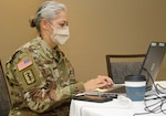 Florida National Guard Maj. Jacqueline S. Zuluaga, 256th Medical Company Area Support company commander, works on mission requirements for scheduling of long-term care facility COVID-19 testing. The FLNG is working closely with federal, state and local partners during the pandemic.