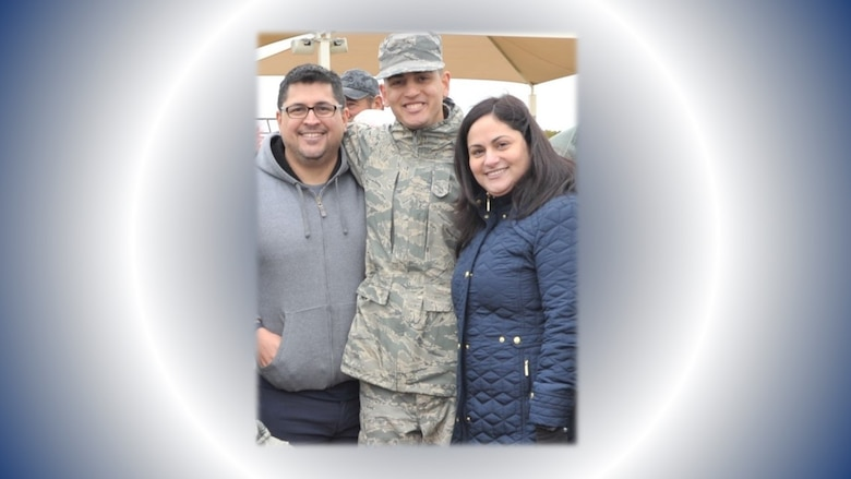 Airman Basic Kevin Rios Rivera and his parents pose for a post-graduation photo following his Nov. 8, 2019 graduation from basic military training at Joint Base San Antonio-Lackland, Texas. Airman Rios Rivera is now a career development technician in the 340th FTG Military Personnel section. As the May On the Spot Award winner, he'll be able to park in the group commander's parking space for a week, once members are able to return to work on base. (U.S. Air Force photo by Debbie Gildea)