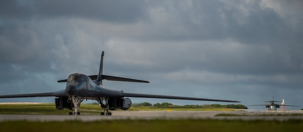 Two 9th Expeditionary Bomb Squadron B-1B Lancers taxi after landing at Andersen Air Force Base, Guam, May 22, 2020. These B-1B aircrews just completed a 24-hour mission that included a large force exercise. The 9th EBS is deployed to Andersen Air Force Base, Guam, as part of a Bomber Task Force supporting Pacific Air Forces' strategic deterrence missions and  commitment to the security and stability of the Indo-Pacific region. (U.S. Air Force photo by Senior Airman River Bruce)