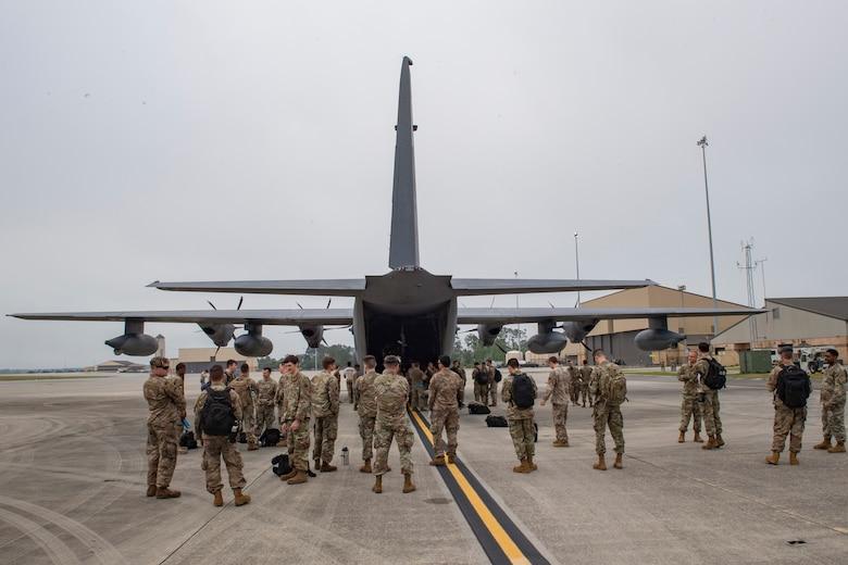 A photo of Airmen waiting to board an aircraft