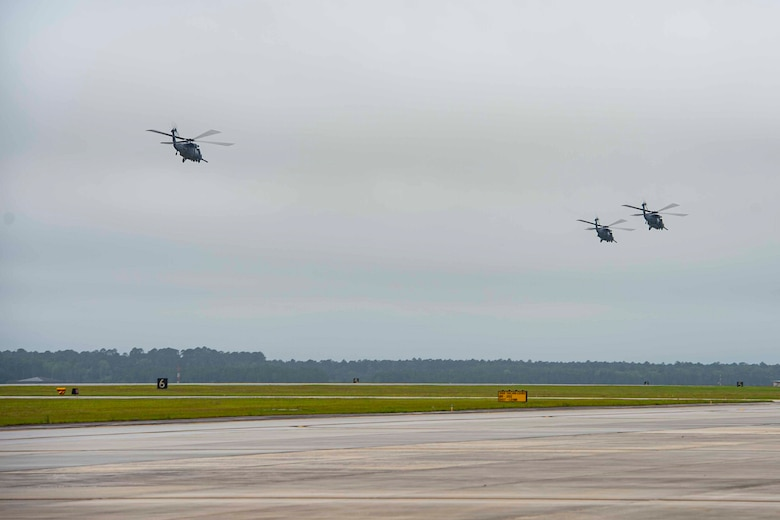 Photo of three HH-60G Pave Hawks assigned to the 41st Rescue Squadron taking off.
