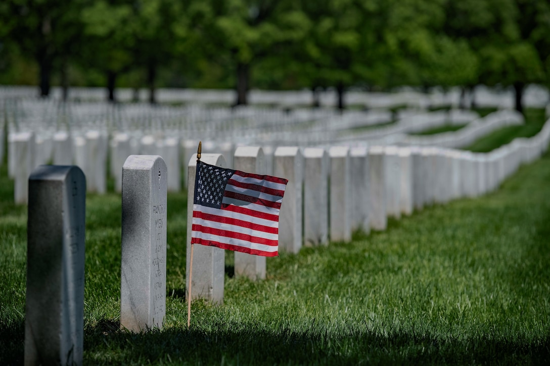 A U.S. flag is placed at a headstone in Section 60 of Arlington National Cemetery, Arlington, Virginia, May 4, 2020. (U.S. Army photo by Elizabeth Fraser / Arlington National Cemetery / released)