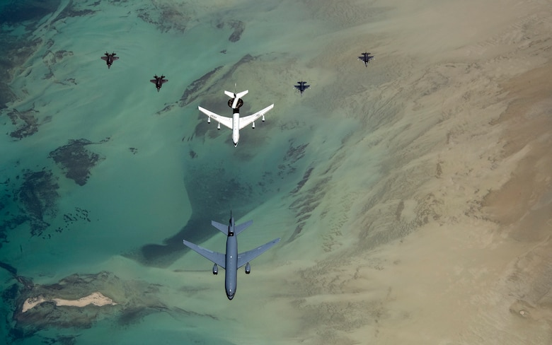 Aircraft with the 380th Air Expeditionary Wing fly in formation