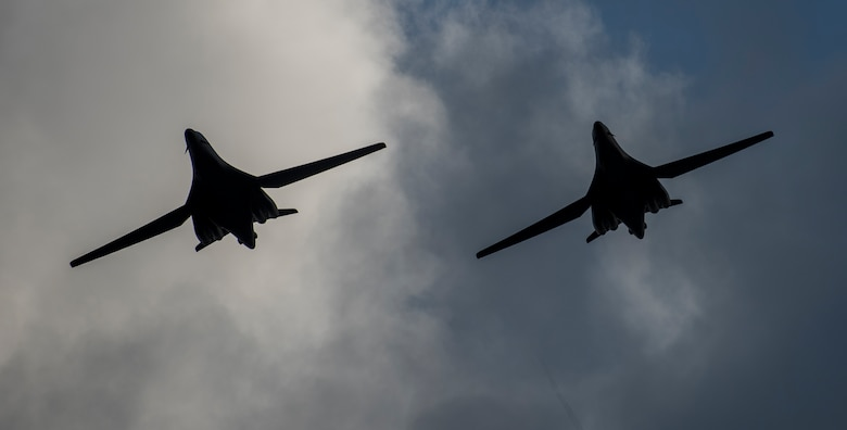 Two 9th Expeditionary Bomb Squadron B-1B Lancers fly in formation before landing at Andersen Air Force Base, Guam, May 22, 2020. These B-1B aircrews just completed a 24-hour mission that included a large force exercise. The 9th EBS is deployed to Andersen Air Force Base, Guam, as part of a Bomber Task Force supporting Pacific Air Forces' strategic deterrence missions and  commitment to the security and stability of the Indo-Pacific region. (U.S. Air Force photo by Senior Airman River Bruce)